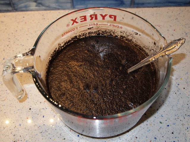 Four cups of water added to ground coffee