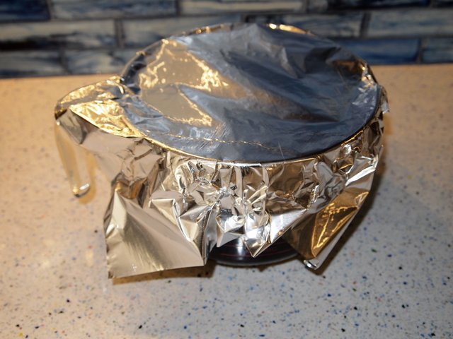 Covered with foil so dust and such will not fall into it